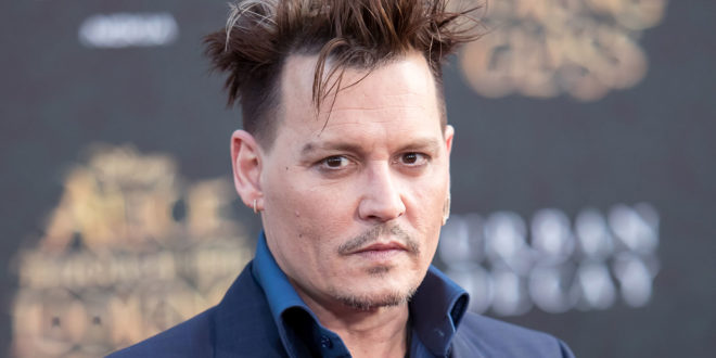 """HOLLYWOOD, CA - MAY 23: Actor Johnny Depp attends the premiere of Disney's """"Alice Through The Looking Glass"""" at the El Capitan Theatre on May 23, 2016 in Hollywood, California. (Photo by Michael Boardman/WireImage)"""